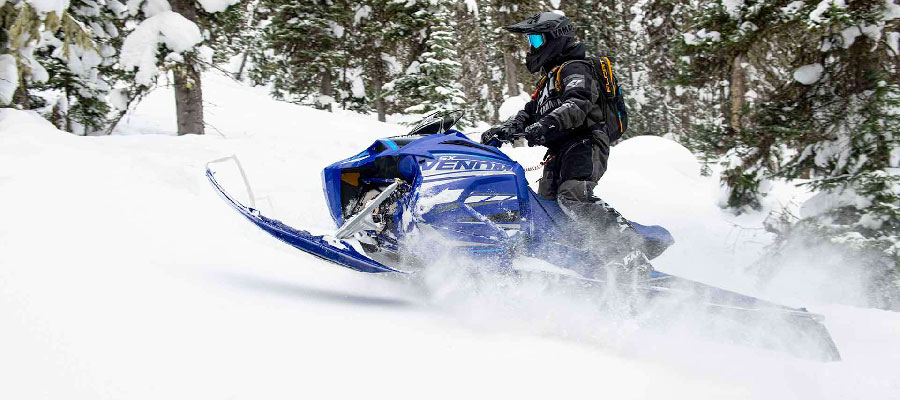 Yamaha Snow Mobile, found at Uxbridge Mower, going up a mountain